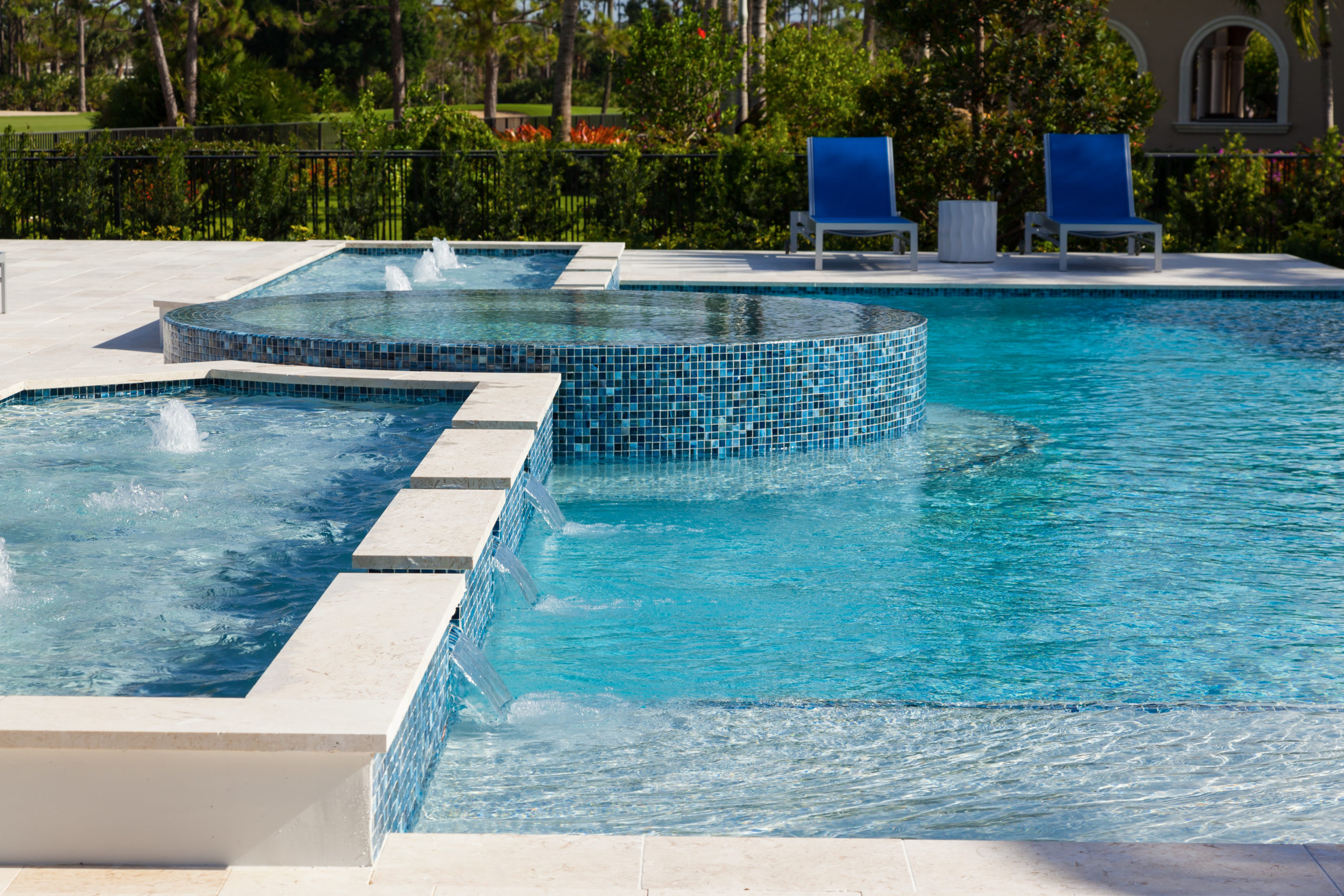 rhr pools of jupiter fl raised infinity spa with water features