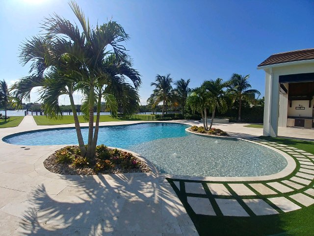 rhr pools of jupiter fl large organic shaped pool with sunshelf and bubbler