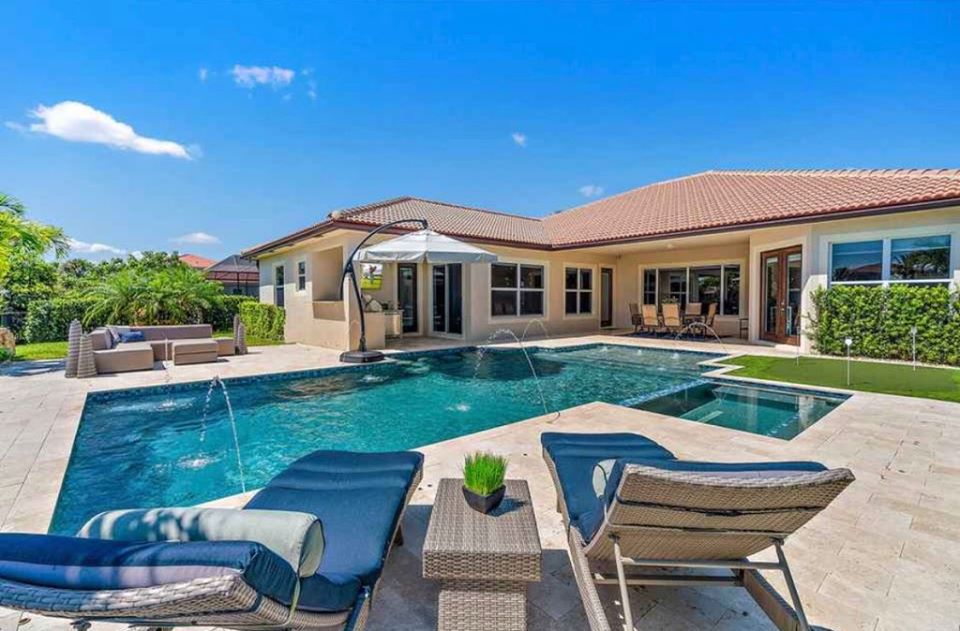 rhr pools of jupiter fl rectangular style pool with spa and water features