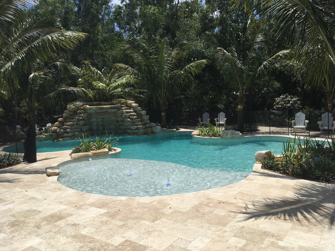 rhr pools of jupiter fl organic shaped pool with rock waterfall feature