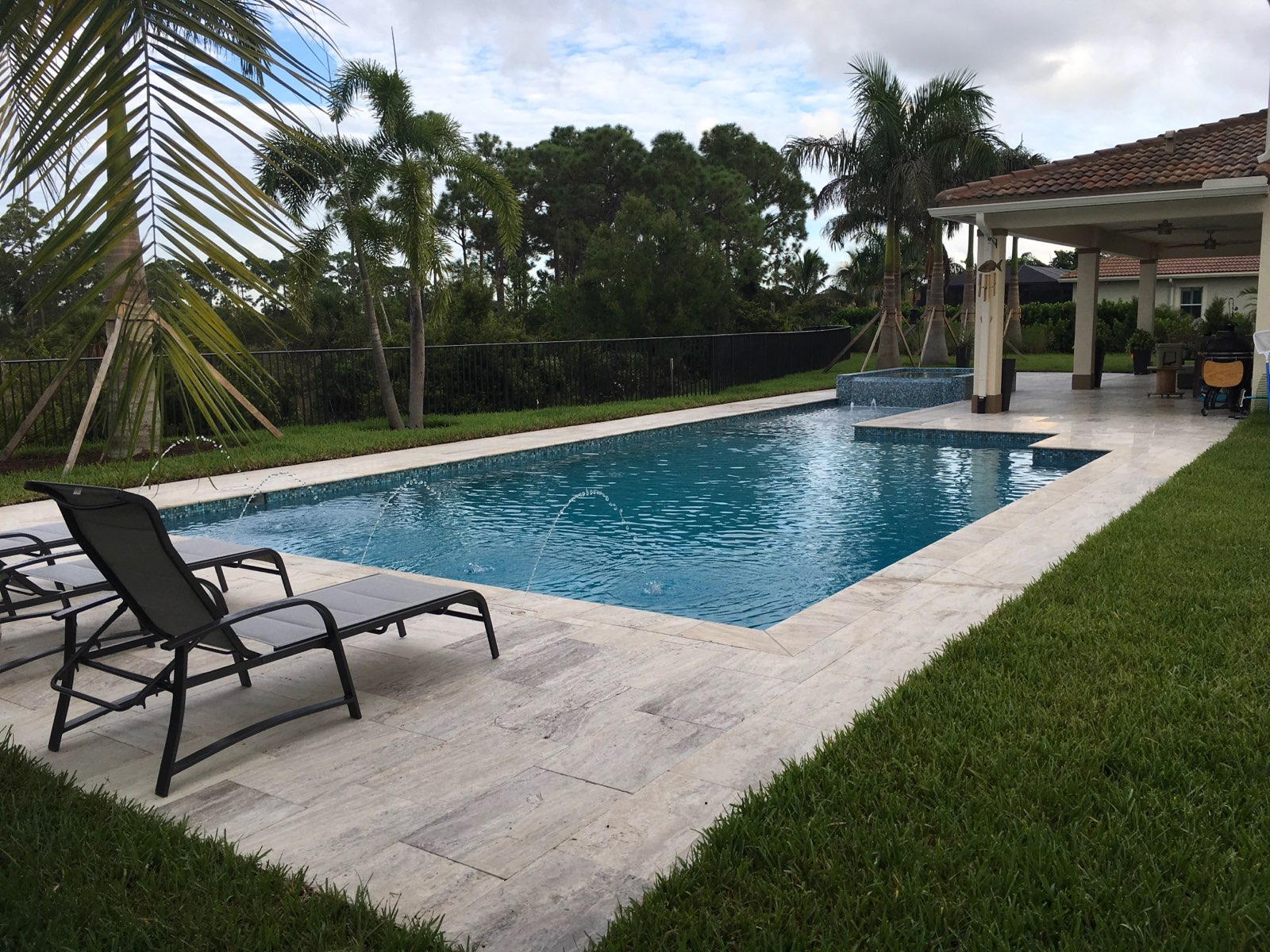 rhr pools of jupiter fl classically shaped pool with raised spa and water features