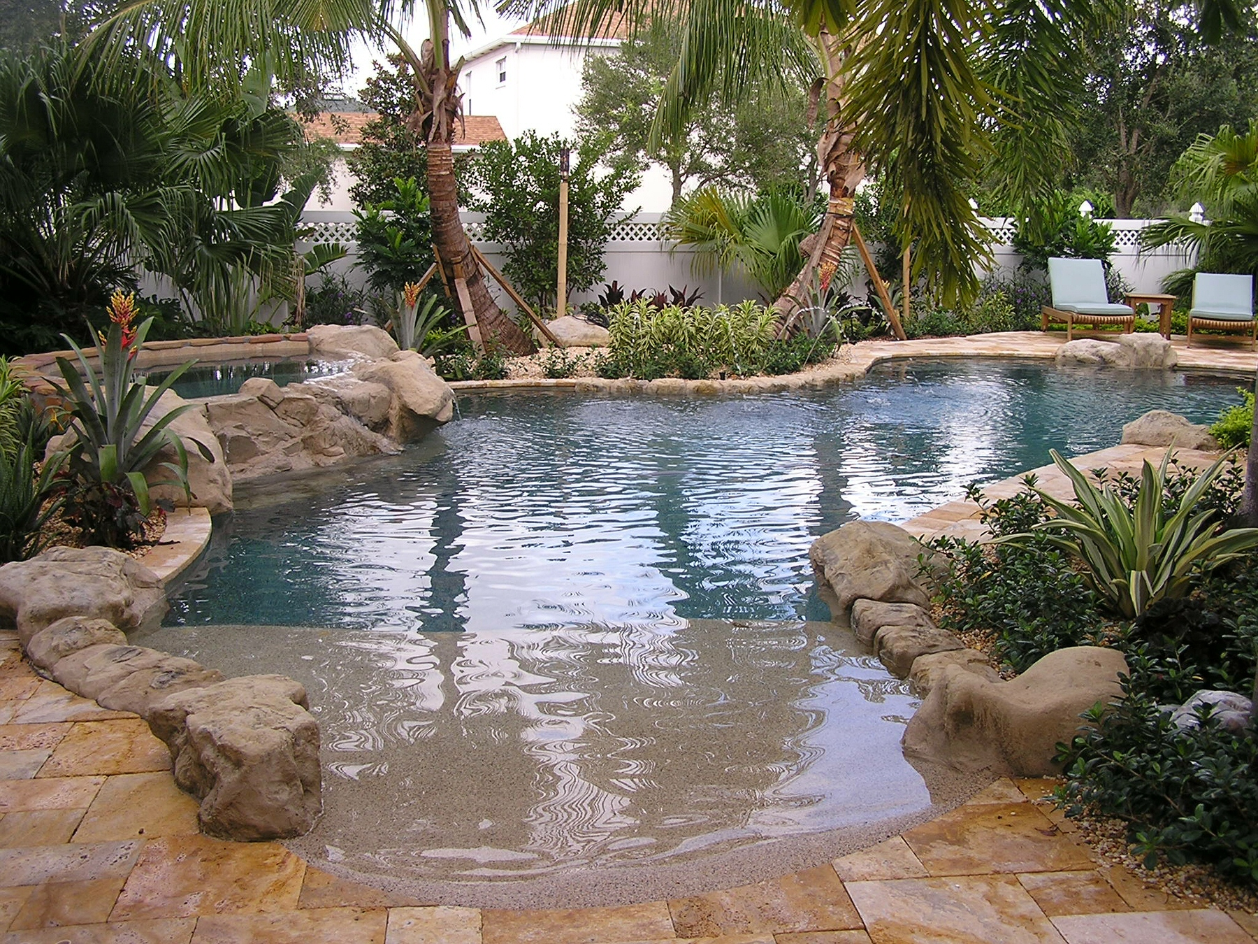 rhr pools of jupiter fl natural florida pool with rock features and beach entry