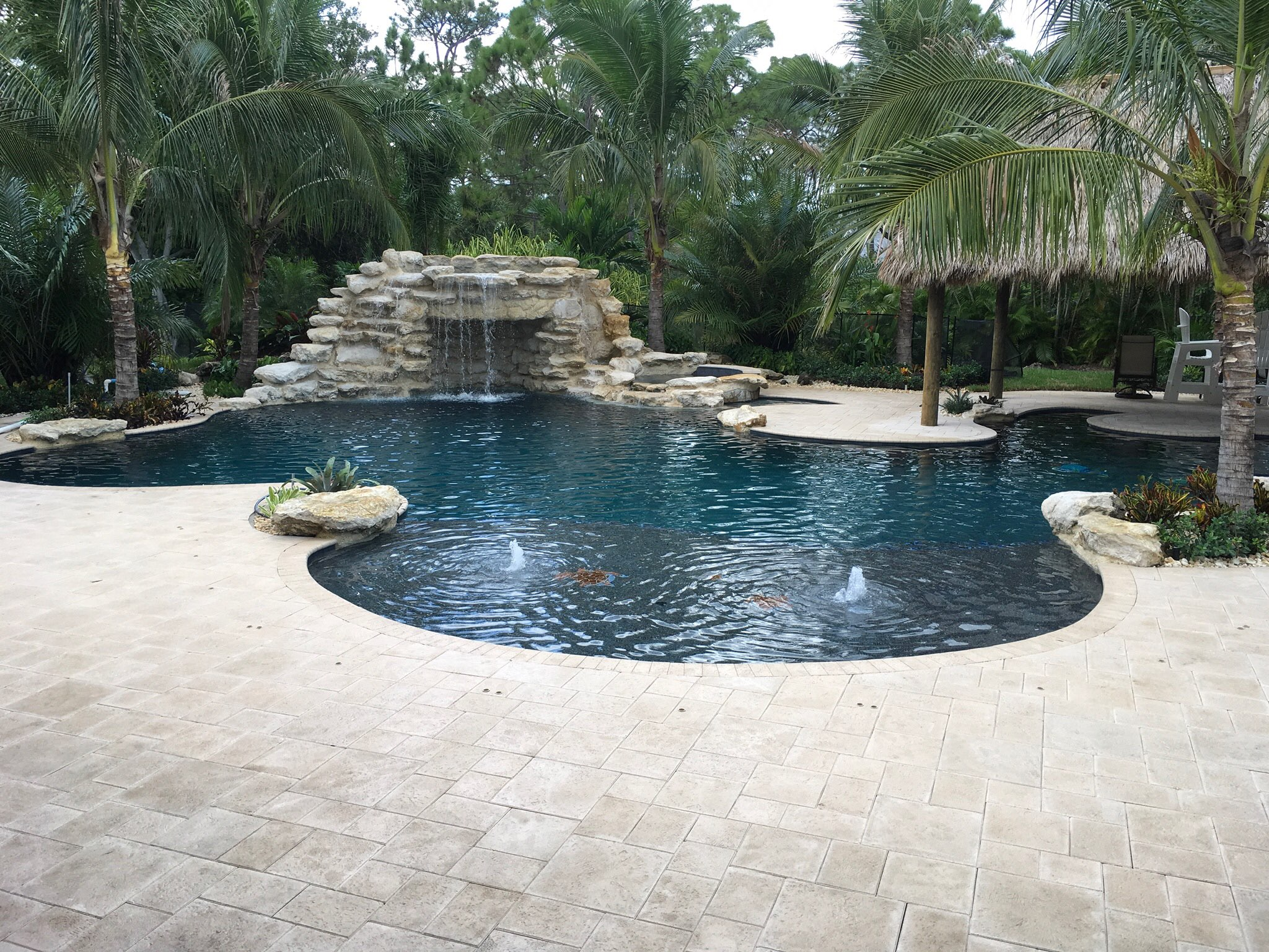 rhr pools of jupiter fl rock waterfall, oversized shelf with bubblers. gorgeous florida pool