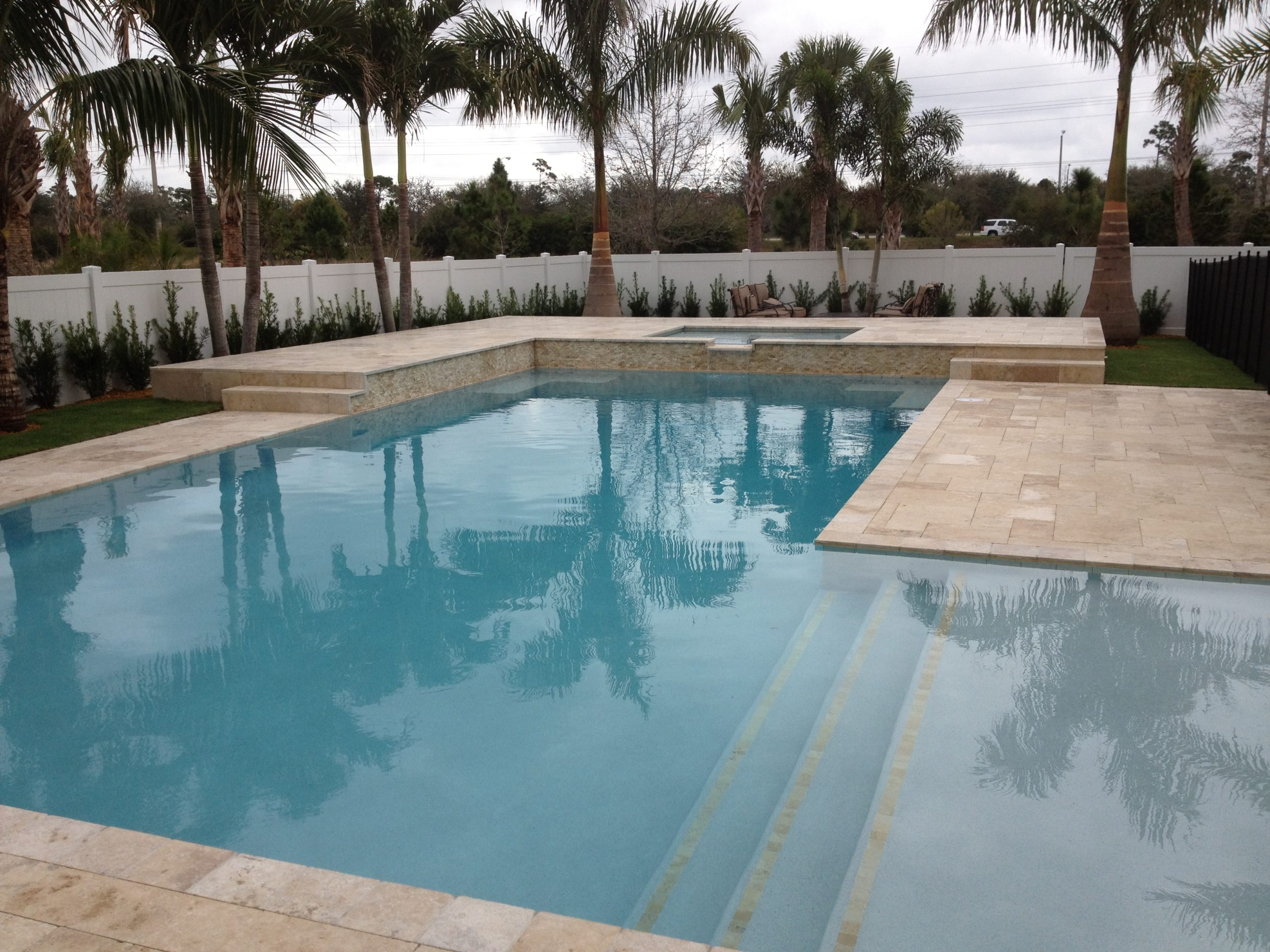 rhr pools of jupiter fl large sunshelf and raised area for entertaining
