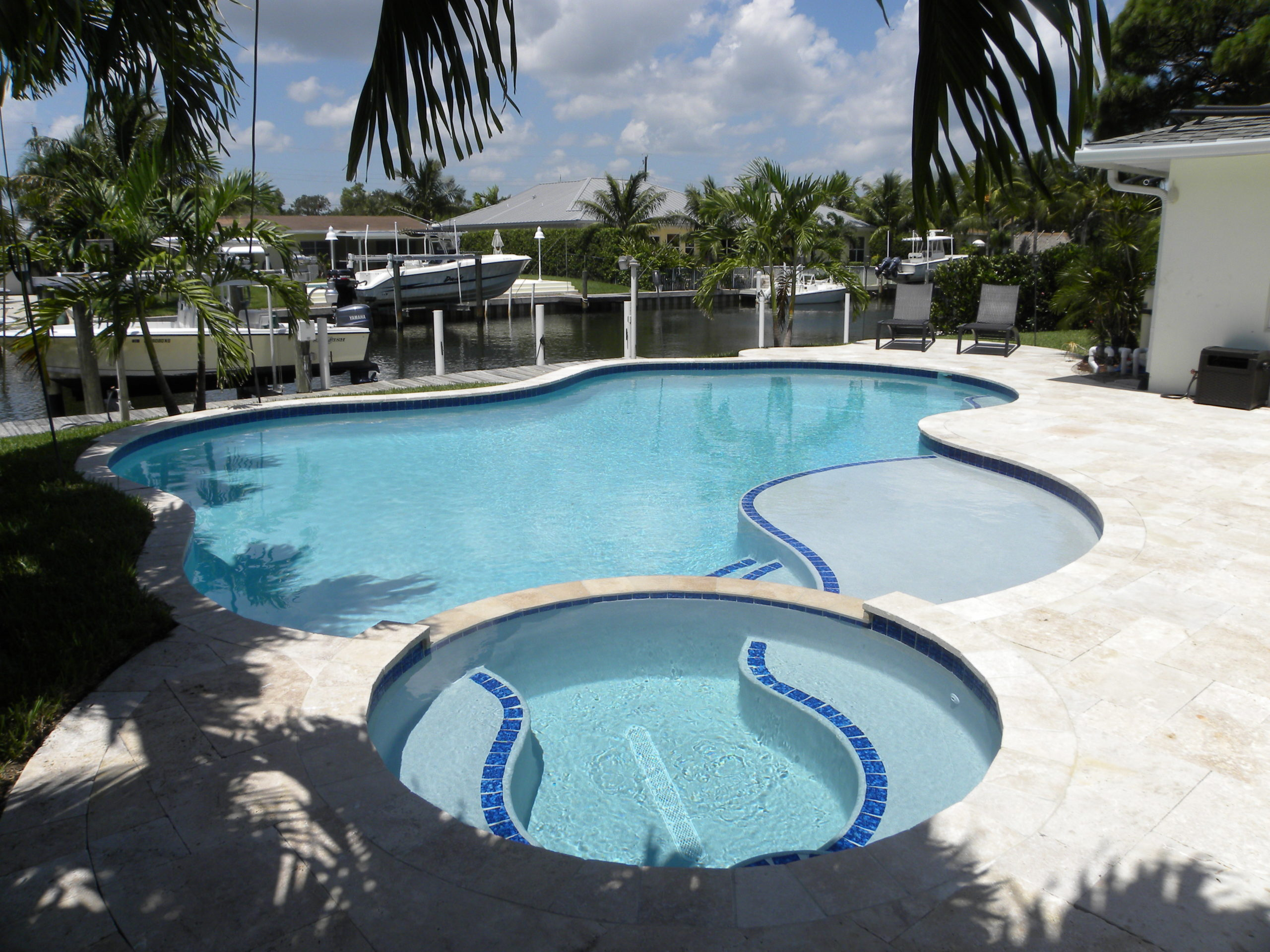 rhr pools of jupiter fl natural shaped pool with oversized step and spa