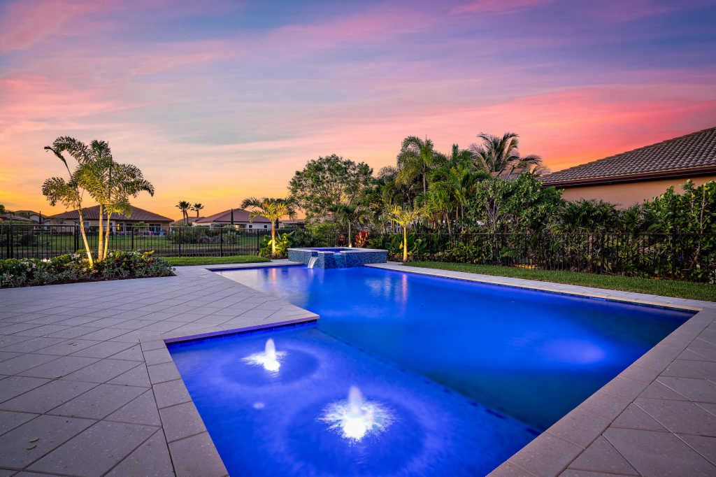 rhr pools bubbler water feature and raised spa with waterfall jupiter fl pool company