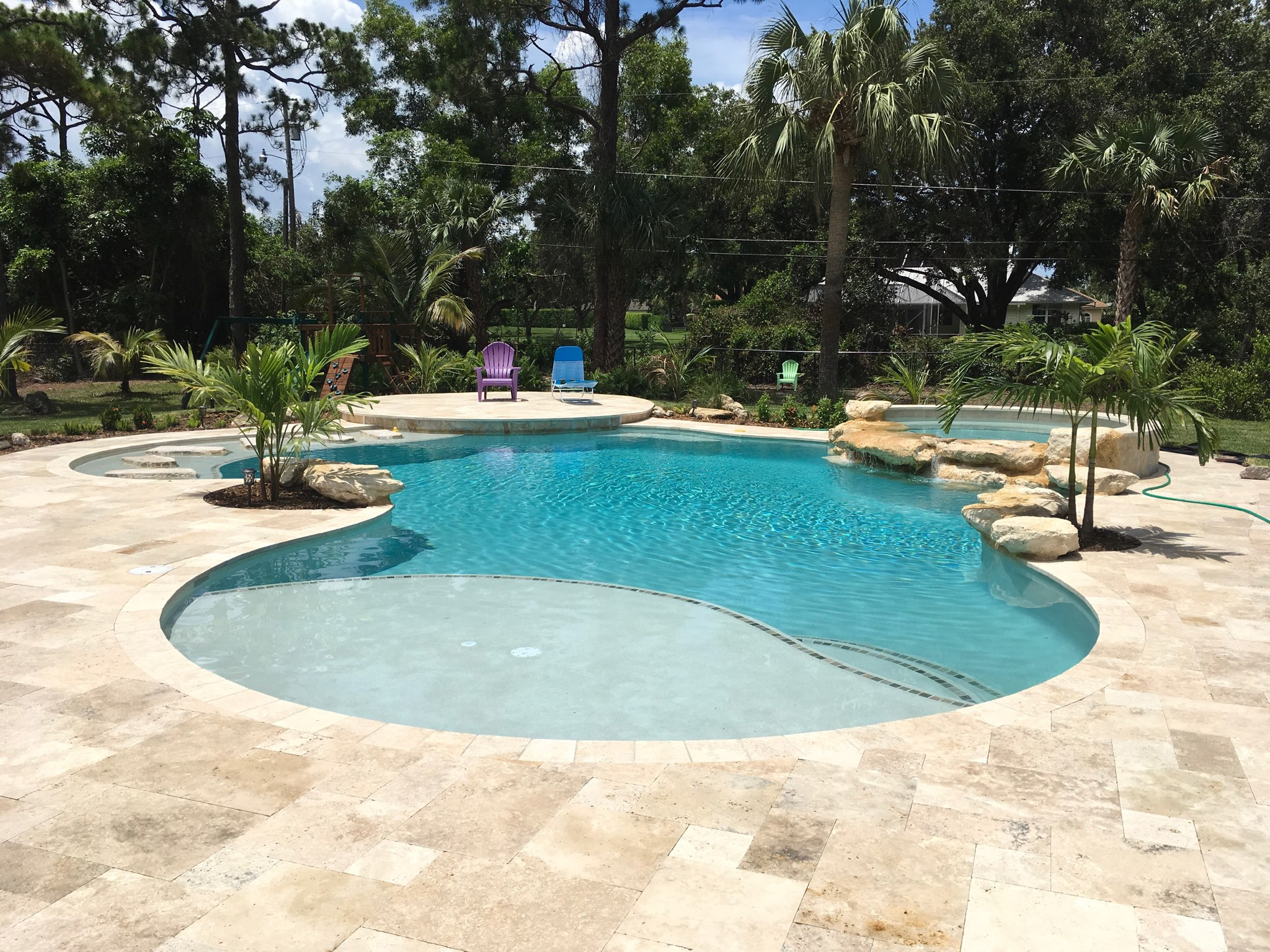 rhr pools of jupiter fl organically shaped pool with rock waterfall edge on the spa and stepping stones