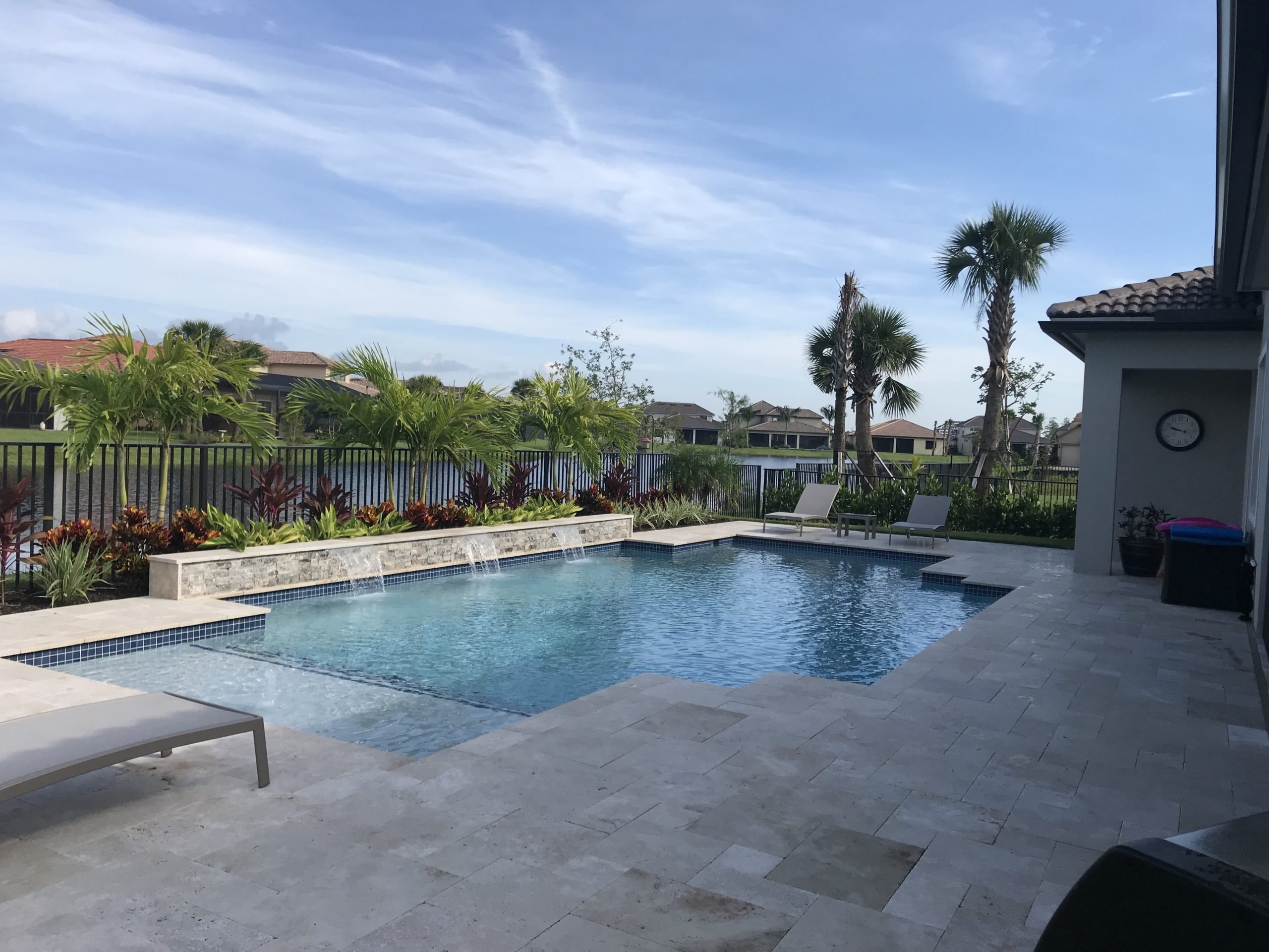rhr pools of jupiter fl custom pool with oversized shelf and water feature