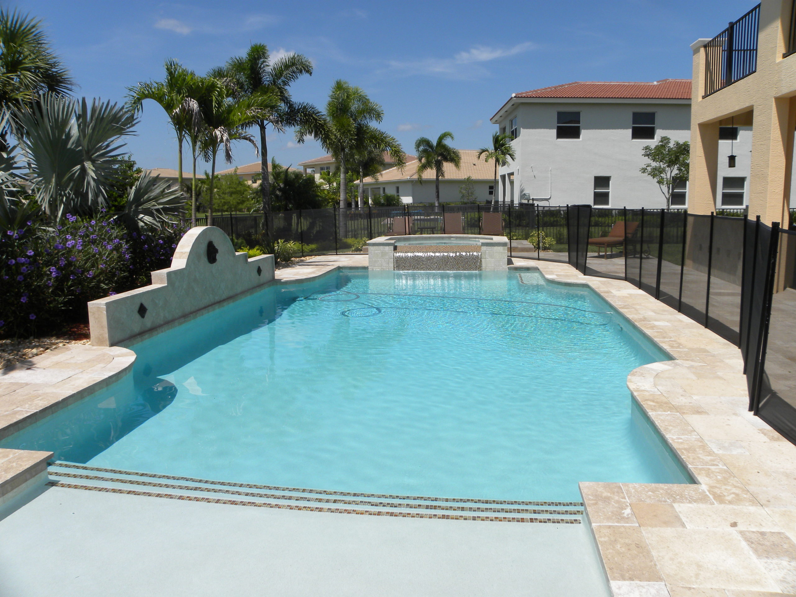 rhr pools of jupiter fl large sunshelf with raised spa and waterfall