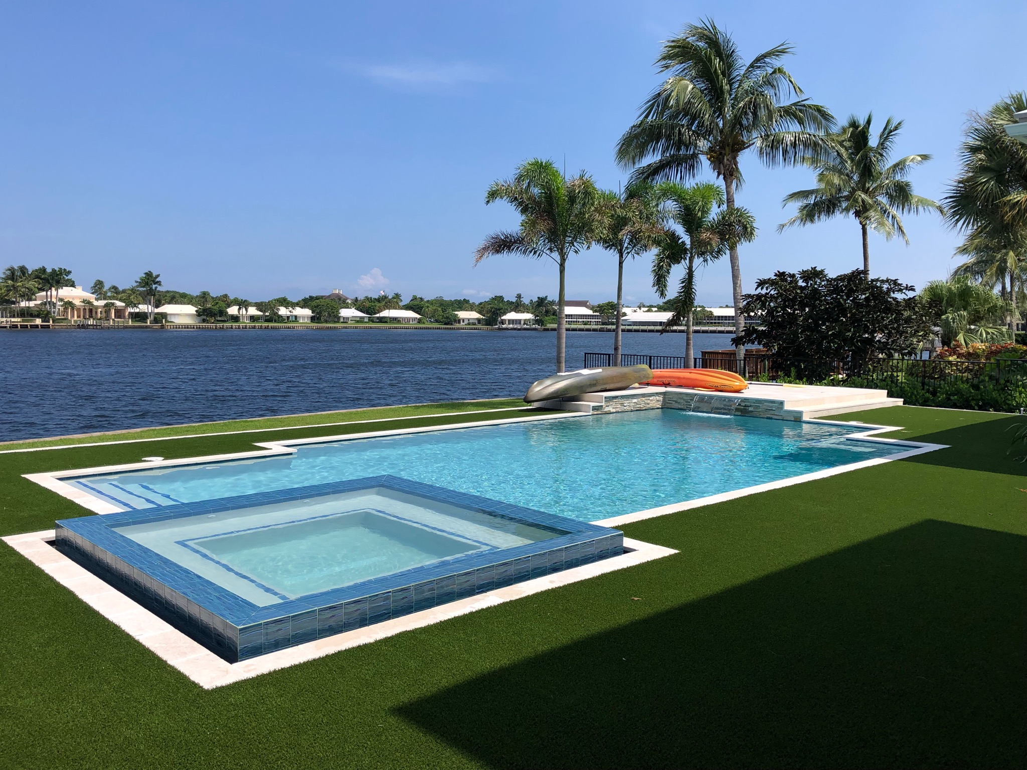 rhr pools of jupiter fl large spa with infinity edge and raised area for entertaining