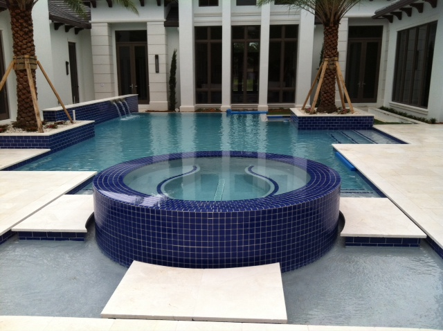 rhr pools circular spa with tiled edge and luxurious water features jupiter fl pool company