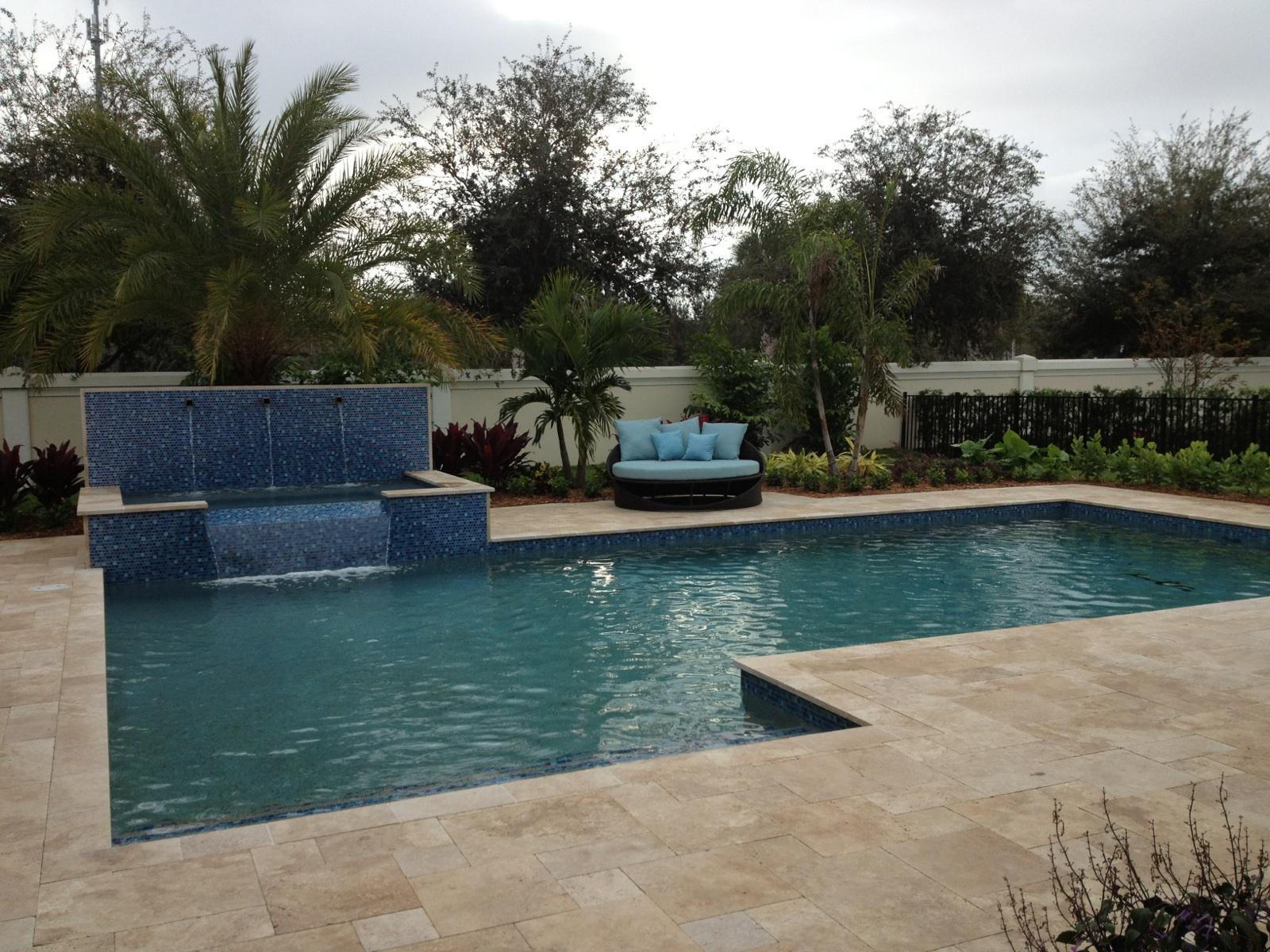 rhr pools of jupiter fl raised spa with raised wall and water features