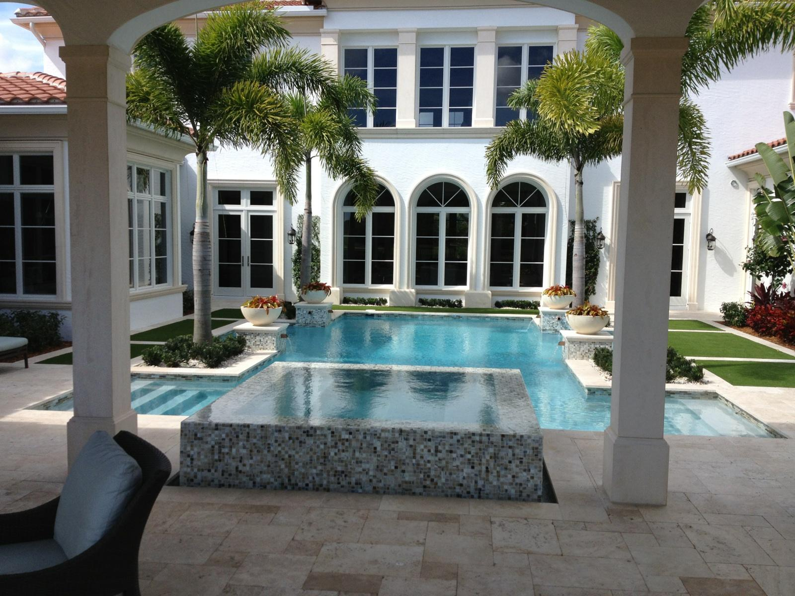 rhr pools of jupiter fl beautiful pool with raised spa and light mosaic tile