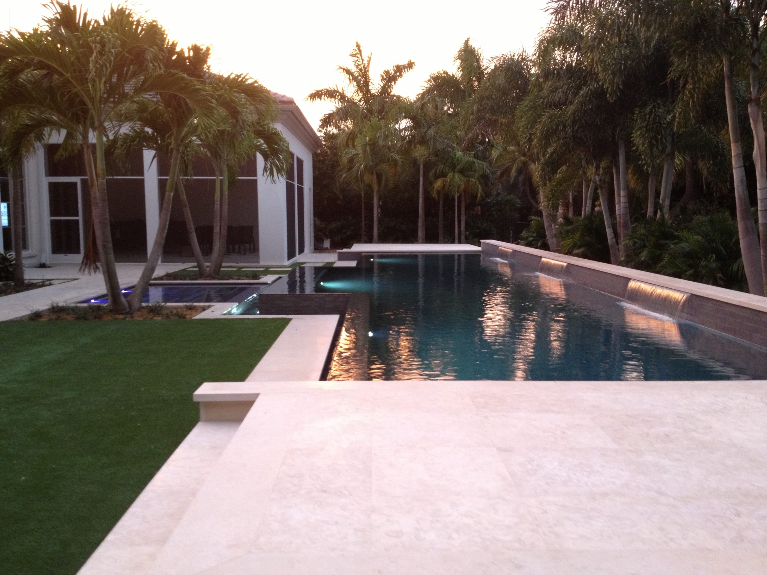 rhr pools of jupiter fl modern pool with led lights and raised wall with sheer decent water feature