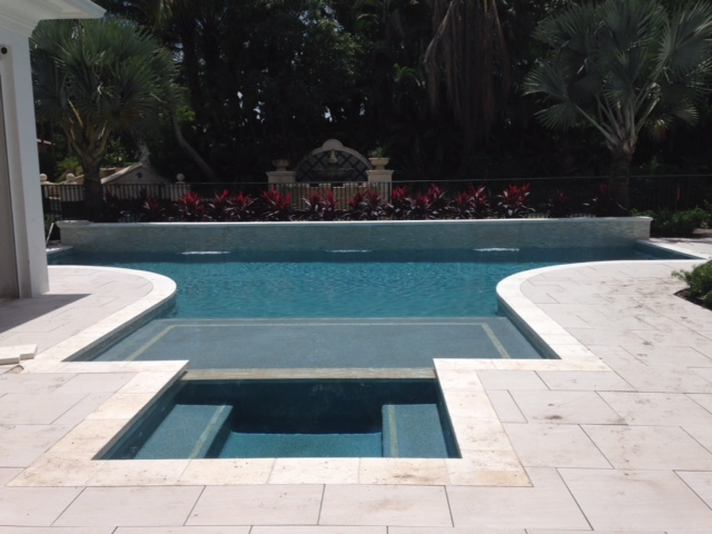 rhr pools oversize sun shelf and water feature in jupiter fl