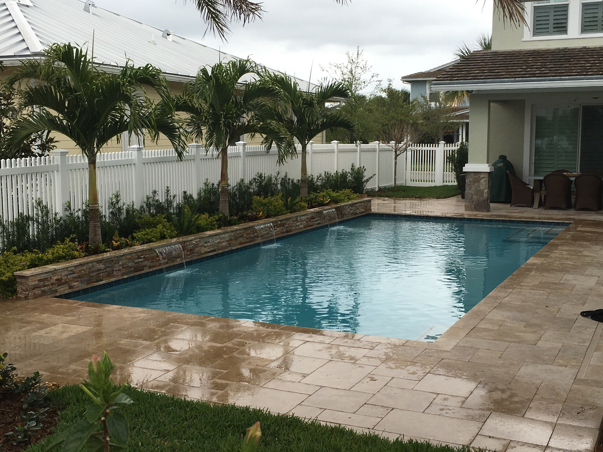 rhr pools of jupiter fl raised wall with water features