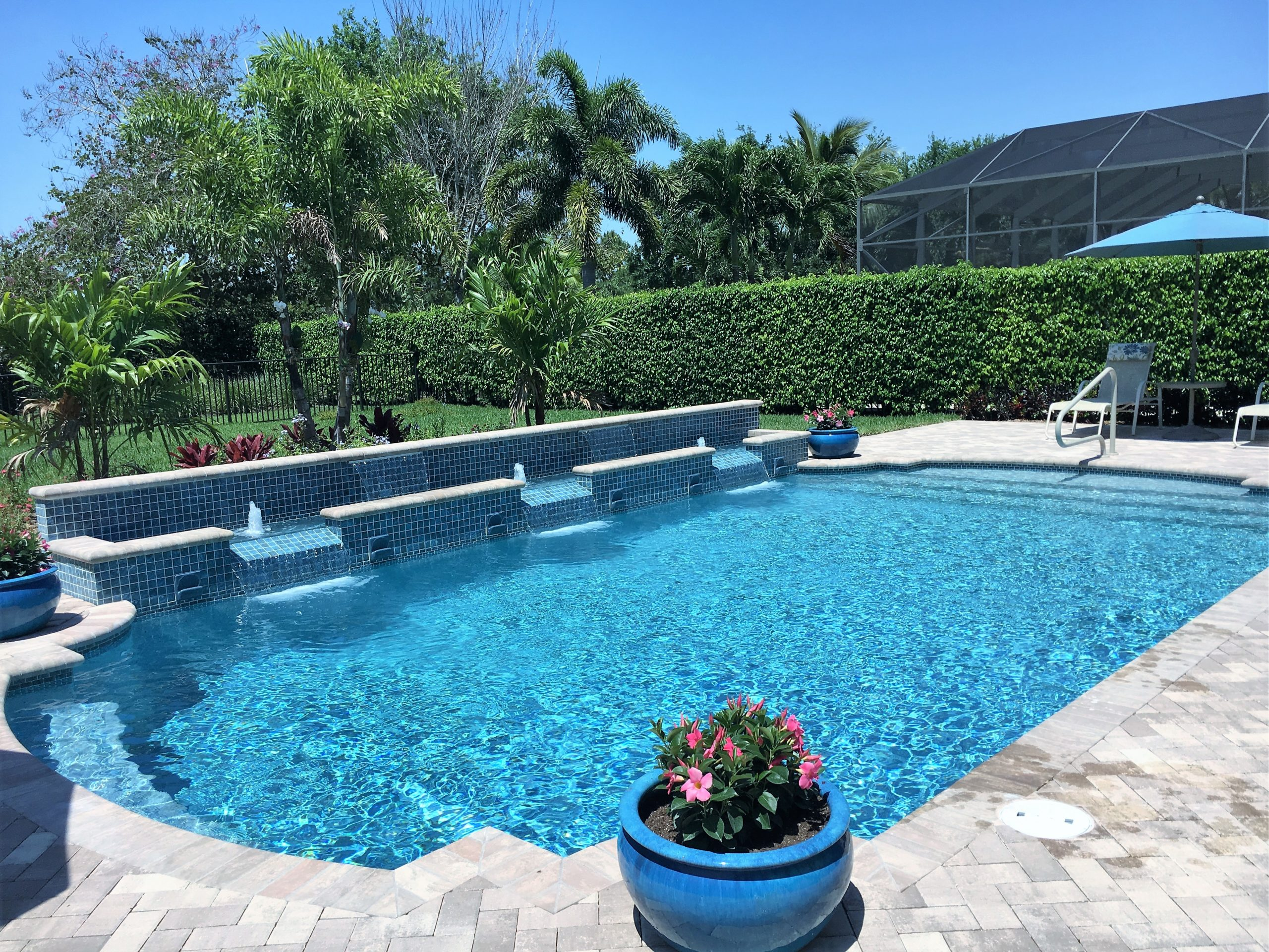 rhr pools of jupiter fl classic shaped pool with waterfeatures