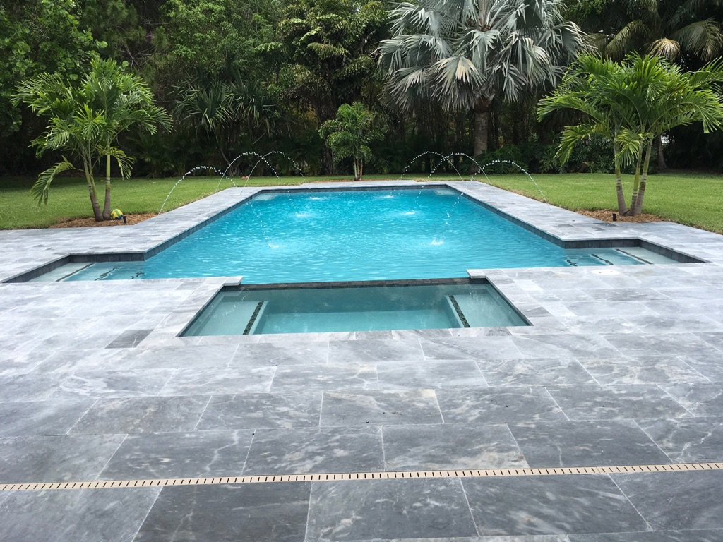 rhr pools of jupiter fl dual steps, sunken spa and water features