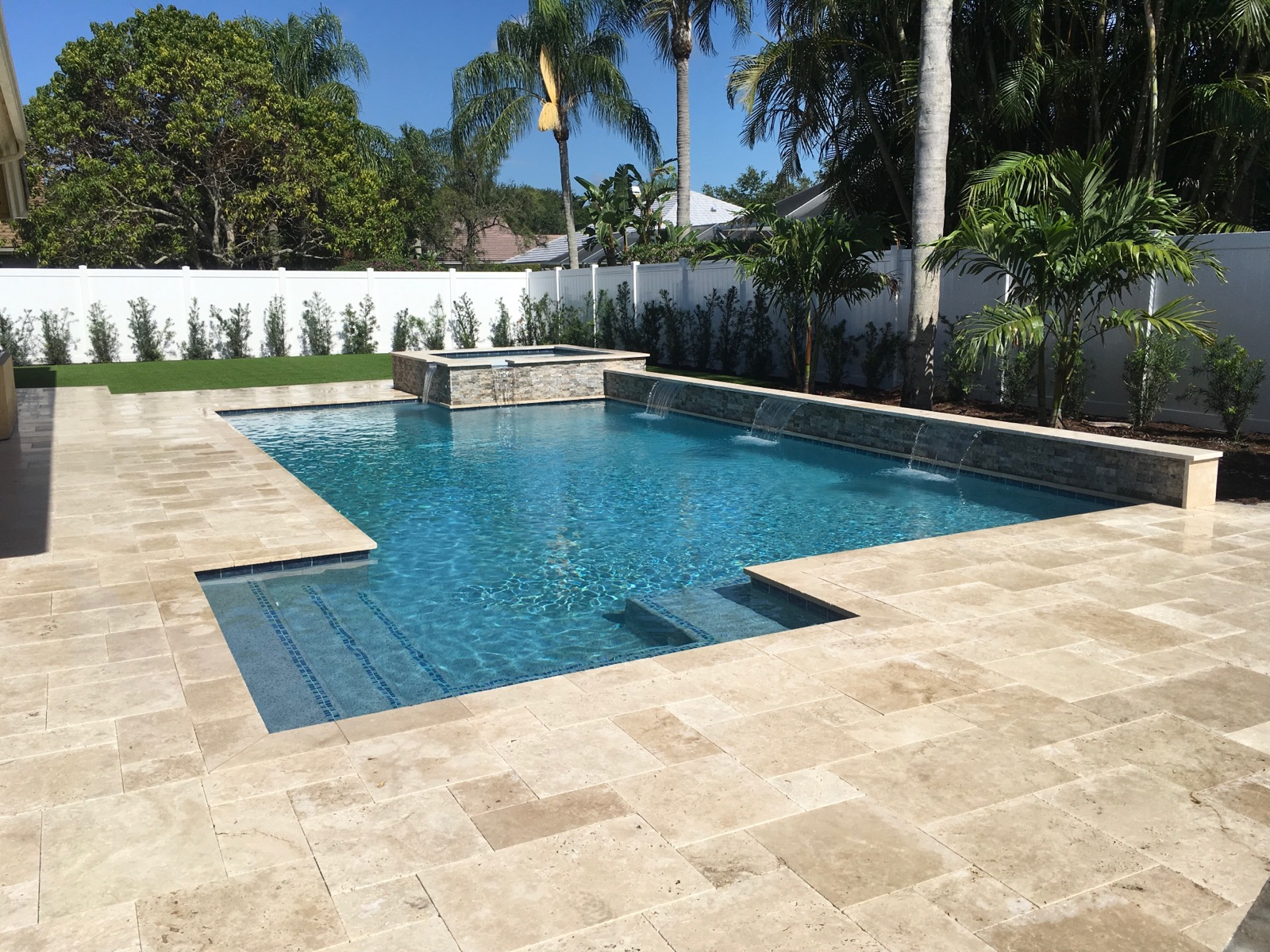 rhr pools of jupiter fl raised spa with water feature