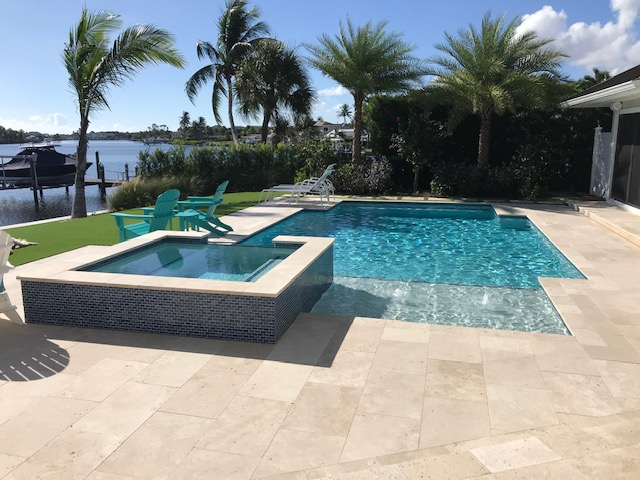 rhr pools raised spa and sun shelf for waterfront home in jupiter fl