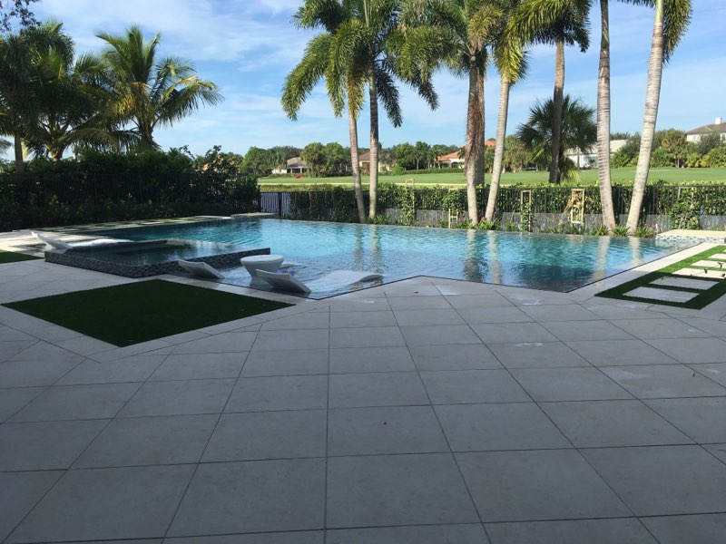 rhr pools infinity edge pool with seating pool company in jupiter fl