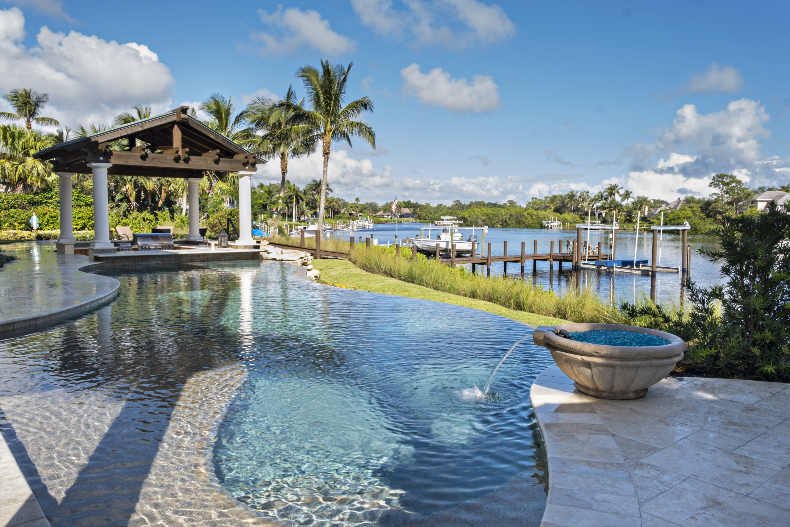 rhr pools of jupiter fl organically shaped pool with water feature overlooking the water