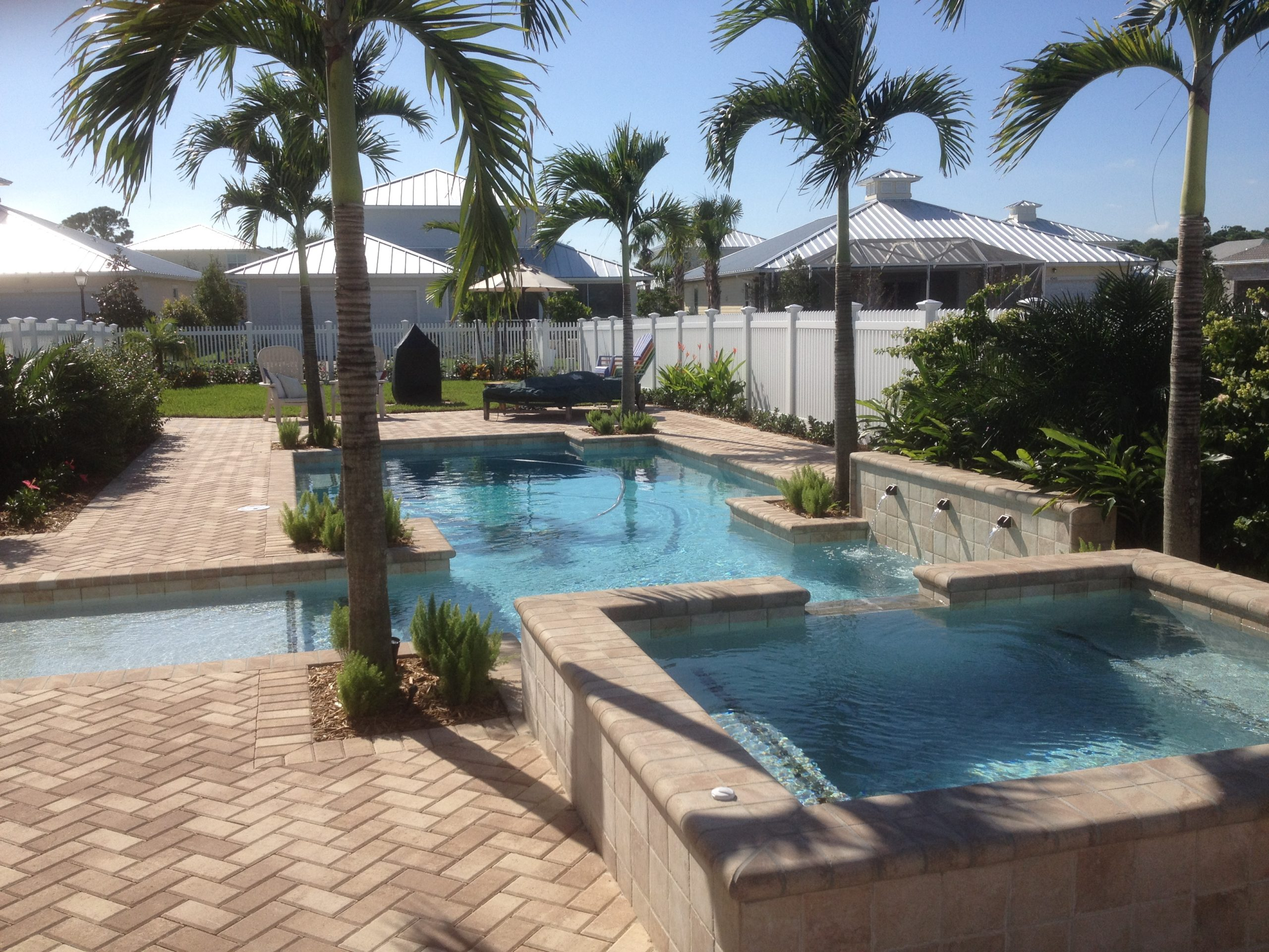 rhr pools of jupiter fl custom pool with raised wall and waterfeatures and spa