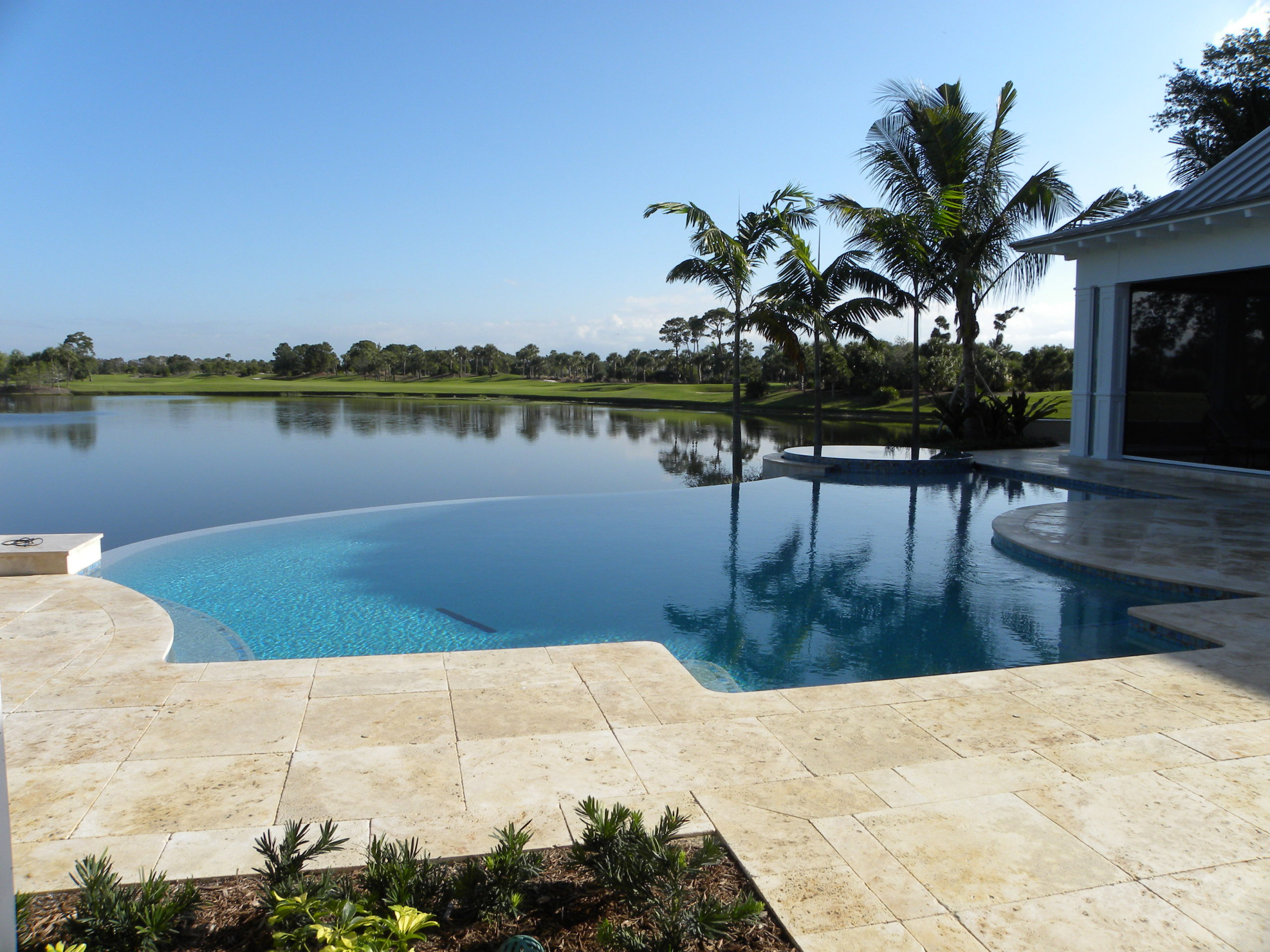 rhr pools of jupiter fl organically shaped pool with infinity edge overlooking the water