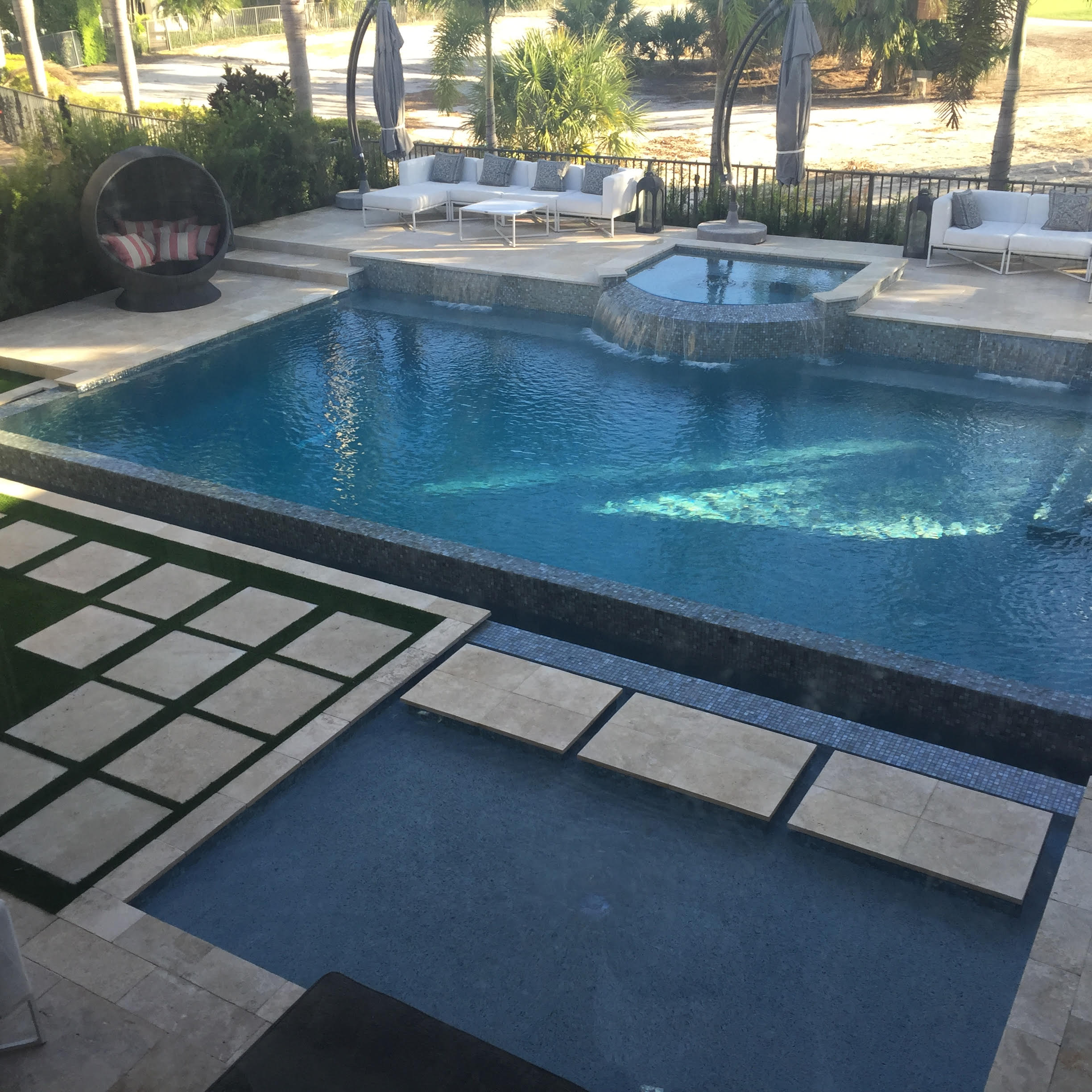 rhr pools of jupiter fl rectangular pool with raised spa and reflection pool
